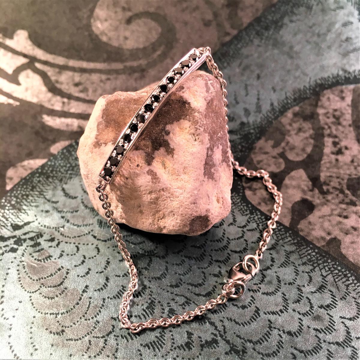 Vitguldsarmband,svarta diamanter,guldarmband