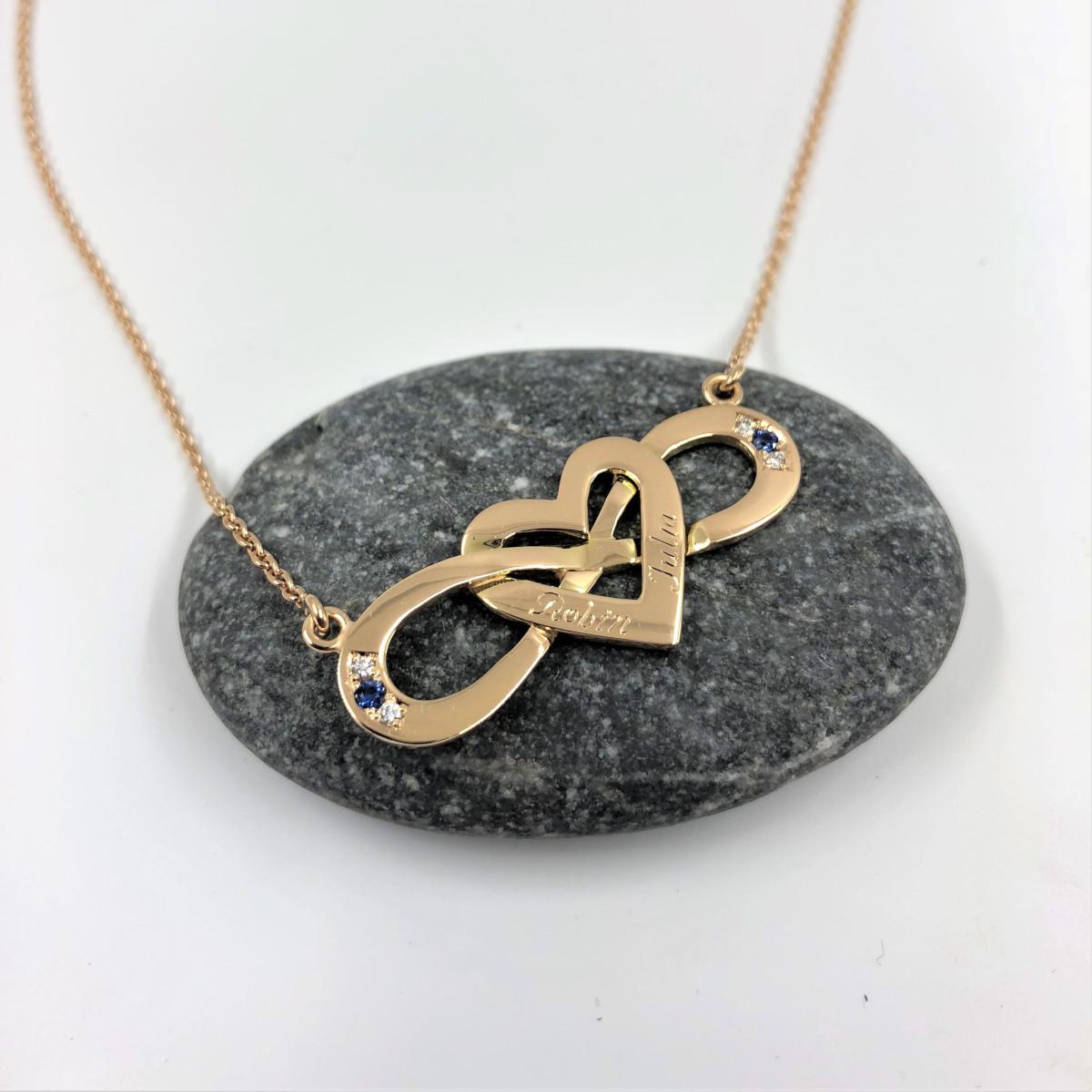 Hängsmycke infinity och hjärta med safirer och diamanter